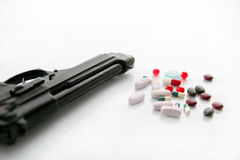 Gun or pills two options to suicide Royalty Free Stock Photo