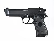 Gun pistol. Sideview of a black hand gun isolated on white Royalty Free Stock Images