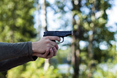 Gun - pistol (armed man) stock image