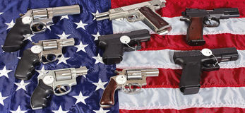 Gun Pistol Firearms For Sale on USA American Flag Stock Photo