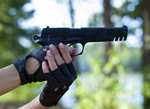 Gun - pistol & french nails Stock Images