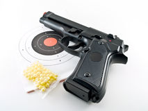 Gun pistol practice set. Photo of a soft air training set with plastic bullets and target papers Stock Image