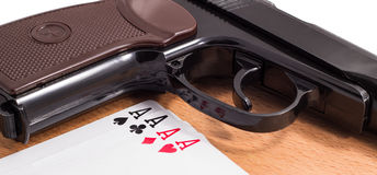 Gun and playing cards stock image