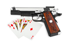 Gun and playing cards Royalty Free Stock Photo