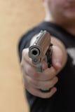 Gun pointed toward the camera Royalty Free Stock Images