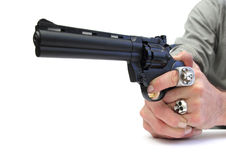 Gun pointing. Closeup of two hands pointing a gun over white Royalty Free Stock Photography