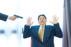 Gun pointing to business man Stock Photography