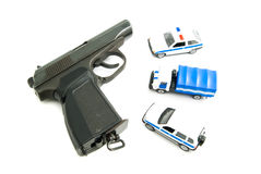 Gun and police cars on white. Background closeup Stock Image
