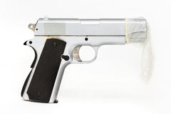 Gun protected by a condom. safe sex. Isolated on  a white background Stock Images