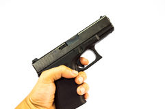 Gun. Pull a trigger gun isolate bakground Royalty Free Stock Photo