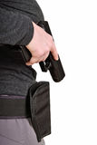 Gun pulled from the holster stock image