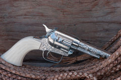 Gun replica toy on rawhide rope with message space Stock Photo