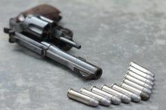 Gun revolver and bullet. Concept Stock Photo
