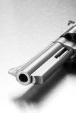 Gun - revolver on steel. Gun on steel - modern revolver closeup, focus on muzzle Stock Photos