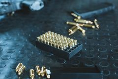 gun and rifle magazines with bullets royalty free stock images