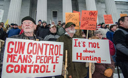Gun rights rally Montpelier Vermont. A Vermont man attending a pro-second amendment rally holds a sign while listening to a speaker during the Guns Across Stock Image
