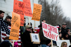 Gun rights rally Montpelier Vermont. A Vermont protesters attending a pro-second amendment rally hold signs while listening to a speaker during the Guns Across Stock Photo