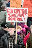 Gun rights rally Montpelier Vermont. A Vermont man attending a pro-second amendment rally holds a sign while listening to a speaker during the Guns Across Royalty Free Stock Images