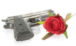 Gun and rose. Stock Images