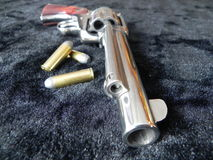 Gun 3. Ruger 45 long Colt revolver with bullets Royalty Free Stock Photography