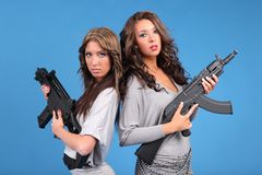Gun safety. Beautiful young women holding rifles safely with their fingers away from the trigger Stock Image
