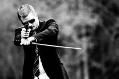 Gun and samurai sword. Man with gun and samurai sword Stock Images