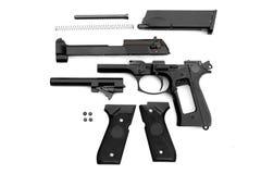 Gun, seperated parts. Disassembled handgun on white background. Seperated parts handgun. Pistol Part royalty free stock images