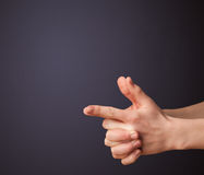 Gun shaped man hand with empty space Royalty Free Stock Images