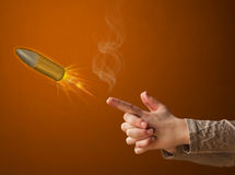 Gun shaped woman hand with bullet Royalty Free Stock Photo