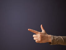 Gun shaped woman hand. With empty space royalty free stock photos