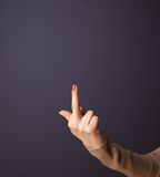 Gun shaped woman hand. With empty space royalty free stock photography