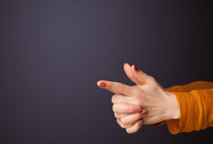 Gun shaped woman hand. With empty space stock photo