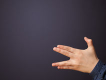Gun shaped woman hand. With empty space royalty free stock photo