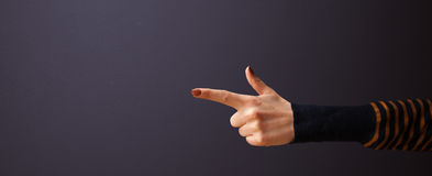 Gun shaped woman hand. With empty space stock image