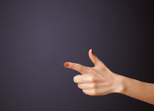 Gun shaped woman hand with empty space Royalty Free Stock Photos