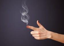 Gun shaped woman hand with smoke. Gun shaped woman hand with white smoke stock photos