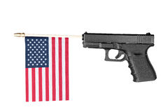 Gun shooting out a flag Stock Photo