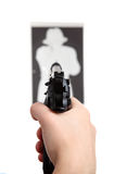 Gun shooting target. Hand with gun shooting target stock photo