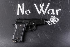 No war. A gun that shoots a flower near to the inscription there is no war stock photography