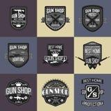 Gun shop logotypes and badges vector set Royalty Free Stock Photo