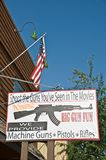 Gun shop sign in West Yellowstone, firearms regulation concept Stock Images