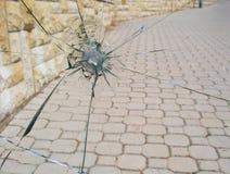 Gun shot window. Shattered glass from a gun shot. Bullet hole. Detail. Shattered glass Stock Photography