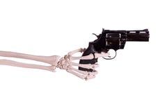 Gun in skeleton hand. On white Stock Image