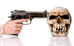 Gun and skull Royalty Free Stock Photos