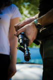 Gun in a solger`s hand. Royalty Free Stock Photography