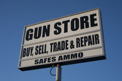 Gun store advertising Stock Images