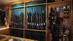Gun store interior with rifles on showcase stock video footage