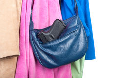 Gun stored in purse Royalty Free Stock Image