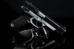 Gun and sunglasses Stock Photography