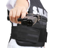 Gun and Swat. SWAT officer pointing pistol to target on white background stock images